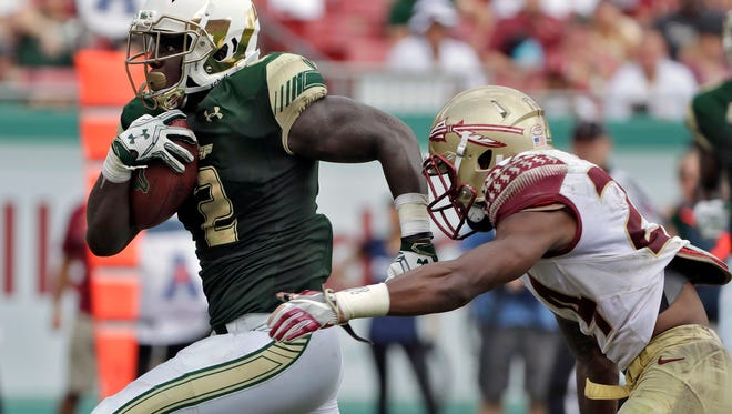 South Florida running back D'Ernest Johnson (2) runs past Florida State defensive back Marcus Lewis for a 24-yard touchdown run during the third quarter of an NCAA college football game Saturday, Sept. 24, 2016, in Tampa, Fla. (AP Photo/Chris O'Meara)