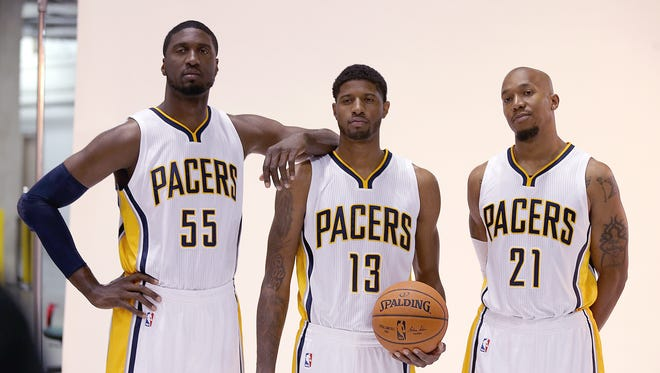 Pacers Roy Hibbert,left, Paul George and David West,right, pose during media day.