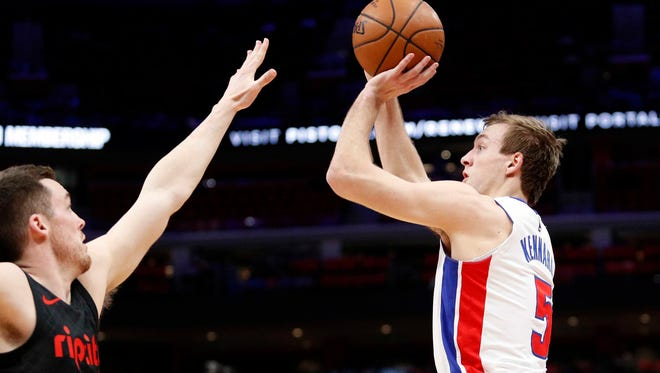 Detroit Pistons guard Luke Kennard (5) takes a shot over Portland Trail Blazers guard Pat Connaughton (5) during the second quarter at Little Caesars Arena, Monday, Feb. 5, 2018.