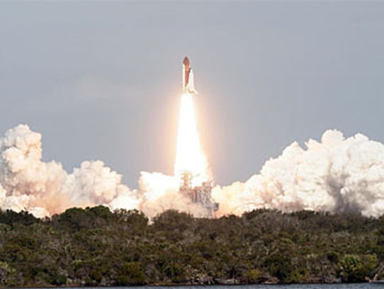 Atlantis begins its 11-day mission to deliver the Columbus,