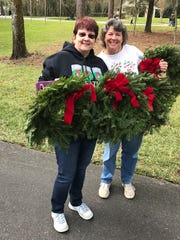 Barbara McKenzie, left, with Charlotte Edendfield on Dec. 16 at Florida National Cemetery in Bushnell for the 2017 national Wreaths Across America day.