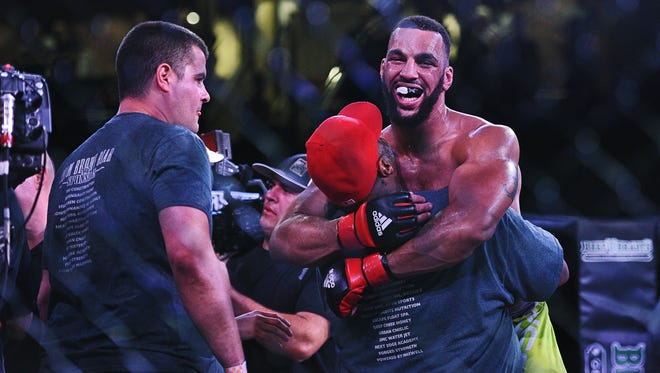 Devin Clark celebrates his light heavyweight title win over Rafael Viana during the Resurrection Fighting Alliance 37 mixed martial arts event Friday, April 15, 2016 at the Sanford Pentagon in Sioux Falls.