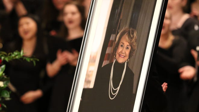 """The choirs sing """"I'll Fly Away"""" at the end of  Louise Slaughter's funeral Friday at Kodak Hall at Eastman Theatre."""