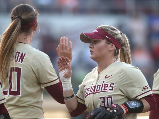 FSU's Jessie Warren high-fives teammates during their