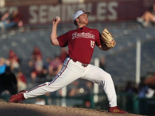 FSU's Andrew Karp pitches against Stetson during their