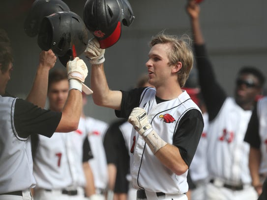 NFC's Carson Neal celebrates his home run with teammates