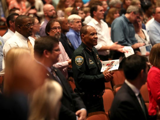 Attendees, including Leon County Sheriff Walt McNeil,
