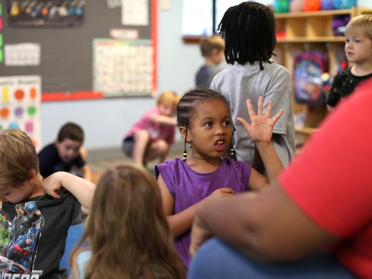 Sophia Magee, 4, talks to Lead Teacher Darielle Veira