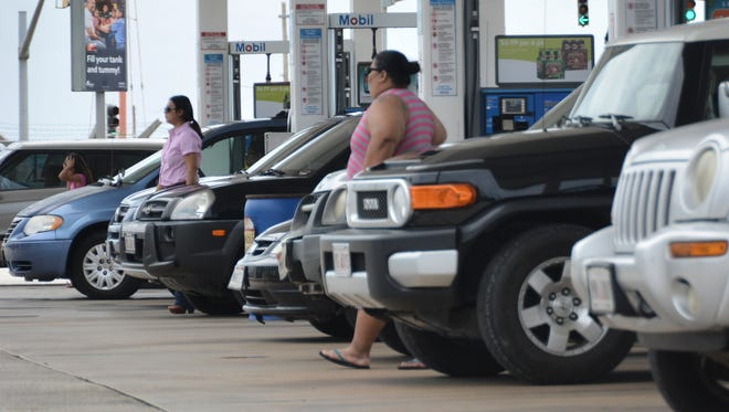 Lines form at the Mobil gas station in Maite on July 2 as customers prepare for Typhoon Chan-hom.