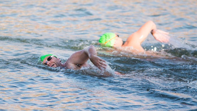 Two Knoxville Open Water Swimmers swim in Fort Loudoun Lake near Calhoun's on the River Thursday, Aug. 3, 2017.  On Sept. 17, the group will hold the inaugural Bridges to Bluffs Open Water Swim.
