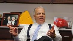 Senate President Stephen Sweeney in his office being