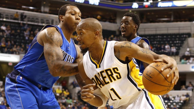 Indiana Pacers' David West, shown here during the Dallas preseason game where he suffered his ankle injury, returns to the Pacers' line-up for his season debut Friday against Orlando.