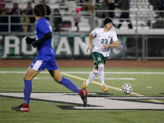 Senior Carlos Pacheco (23) was one of the many returning stars on the Trojans' 2018 title-winning team.