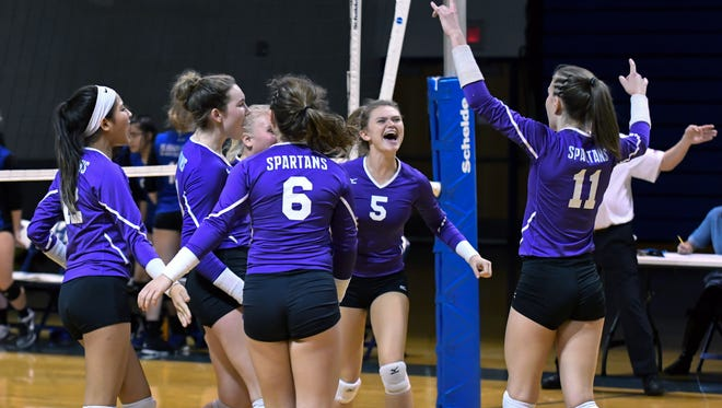 Lakeview teammates celebrate after sweeping Harper Creek during Districts Monday night.