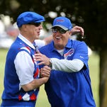 Bills head coach Rex Ryan took a helicopter ride to drop purchased marked golf balls onto a green as part of Jim Kelly's golf charity event in Batavia.