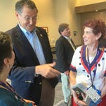Third District Rep. Gregg Harper talks to Rose Anne Reppond of Bossier City, La., left, and her sister Mary Lea Hagan of Jackson after a breakfast Wednesday for Mississippi's delegation to the Republican National Convention. Harper gave Hagan his convention floor pass on Monday for the convention's opening night.