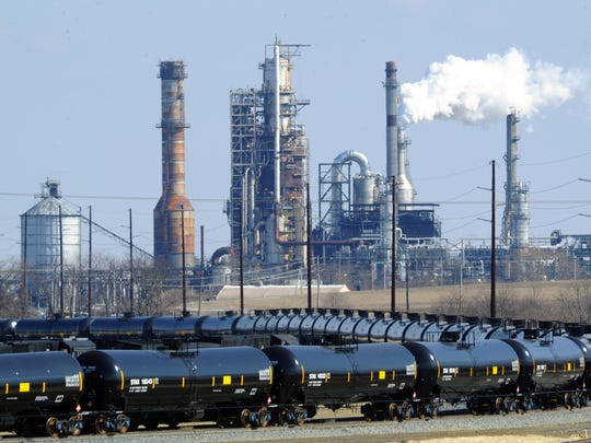 Train cars sit outside the Delaware City Refinery in