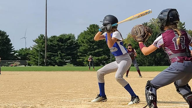 4th photo- Natalie Hawes batting. H. Manning of Williamsfield catching.