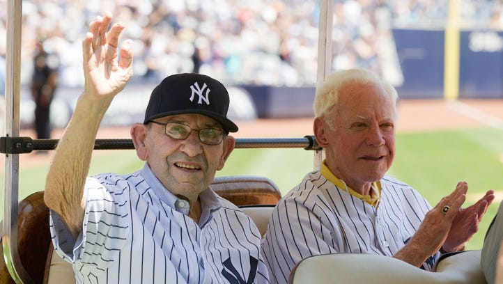 New York Yankees hall of famers Berra (left) and Whitey Ford at the New York Yankees 67th old timers day at Yankee Stadium.