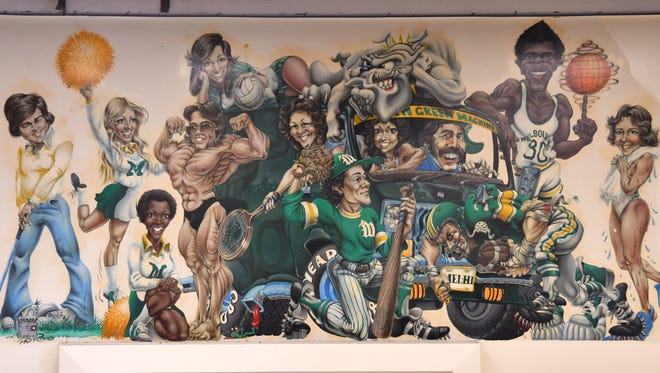 Efforts are being made to save the mural in the wall of the Melbourne High School cafeteria done by well-known artist Phil Roberts.