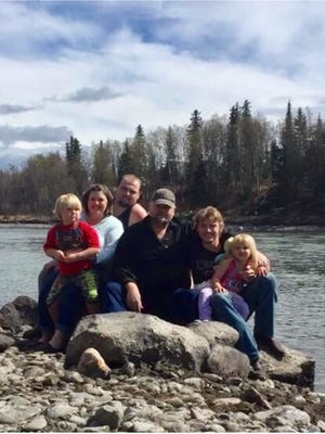 "The Wagner family was the subject of three searches on farms in Pike and Adams counties in May 2017 tied to the Rhoden family massacre. The family photo was taken during a recent trip to Alaska. Pictured from left to right are: Bulvine; Angela Wagner, her son, George, her husband, George ""Billy"", her son, Edward ""Jake,"" and his daughter, Sophia, 3. Jake Wagner is the former longtime boyfriend of Hanna Rhoden, who was killed in the April 22, 2016 killings in Pike County. The two are the parents of Sophia."