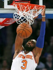 New York Knicks forward Tim Hardaway Jr. (3) dunks in the first half of an NBA basketball game against the Washington Wizards in New York, Wednesday, Feb. 14, 2018.