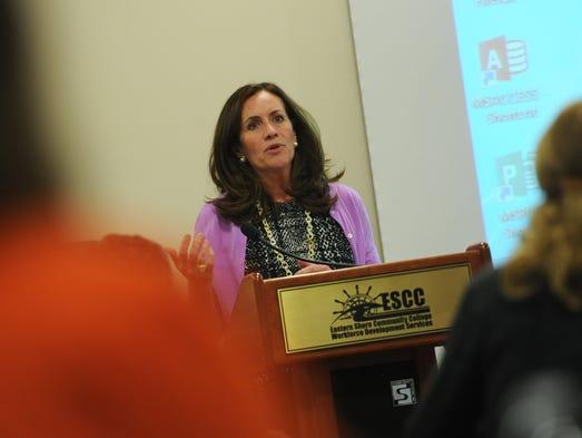 Virginia First Lady Dorothy McAuliffe addresses a large