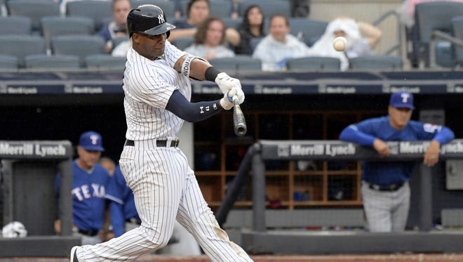 New York Yankees' Miguel Andujar hits a two-run home run during the seventh inning of a baseball game against the Texas Rangers Saturday, Aug. 11, 2018, at Yankee Stadium in New York.
