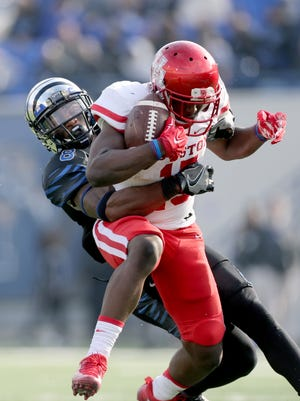 Memphis cornerback Arthur Maulet (8) tackles Houston wide receiver Linell Bonner in the second half of an NCAA college football game Friday in Memphis.