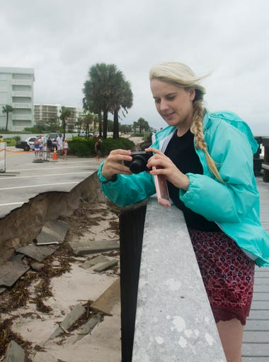"""""""The damage here is not as as bad as it was after the 2004 hurricanes but it's still sad to see what the storm did to our beaches,"""" said Amelia Strazzulla, a Vero Beach native who records video of the damage along the Conn Beach boardwalk in Vero Beach on Friday, October 7, 2016"""
