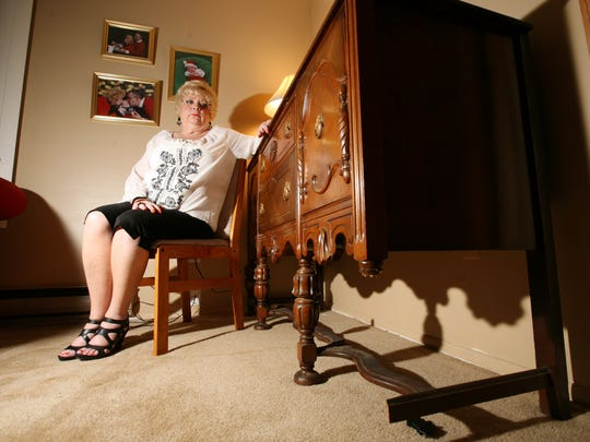 Ocean Gate resident Denise Stiebris could not gigure why she was charged an additional $900 after her mother's buffet table was shipped across the country and damaged in the process.