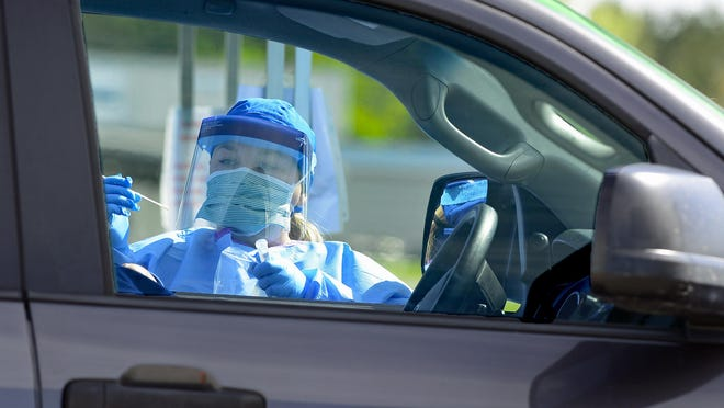 Healthcare personnel work during drive-thru testing for COVID-19 at 12th Street Baptist Church in Rainbow City on Wednesday, April 1, 2020.