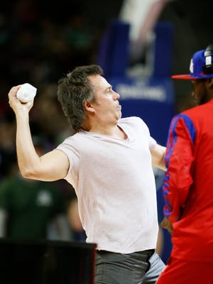 Pistons owner Tom Gores took part in a T-shirt give away during a time-out in the second half of the Pistons' 128-118 win over the Orlando Magic on Wednesday at the Palace.