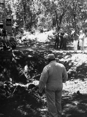 On Sept. 30, 1959, Robert Jones watches as a clamshell crane digs where he believes millions of dollars of gold is buried.