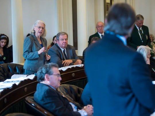 Sen. Peg Flory, R-Rutland, left, interrogates Sen. Phil Baruth, D-Chittenden, right, as he speaks in favor of a measure requiring universal background checks for all gun sales in Vermont at the Statehouse in Montpelier on Thursday, March 1, 2018.