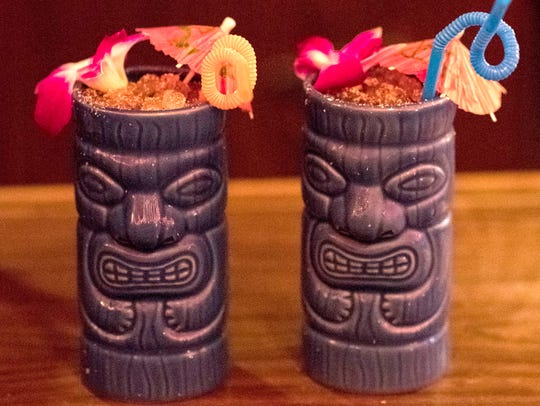 The Painkiller, a rum-based drink, is served in tiki-style