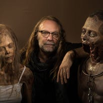 Greg Nicotero, the special effects makeup master of AMC's 'The Walking Dead,' hangs out with replicas of two familiar walker creations.