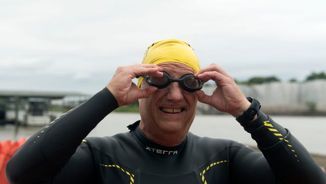 Brian Bischoff gets ready for an open water swim at Fort Loudoun Lake on Thursday.