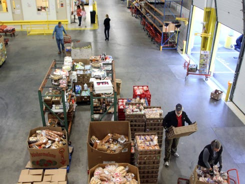 Volunteers gather food at the New Hampshire Food Bank in Manchester, N.H. on Oct. 1, 2013. The temporary increase in food stamps expired Oct. 31, meaning for millions of Americans, the benefits that help them put food on the table every month won't s