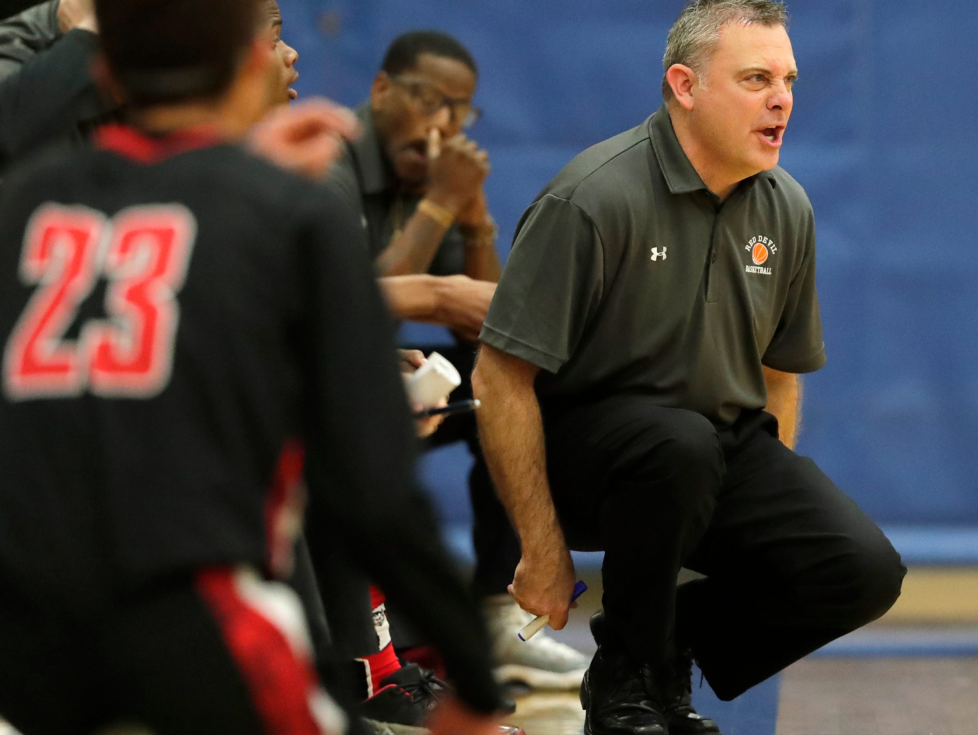 Green Bay East coach Rick Rosinski shouts instructions during a game against Green Bay Southwest on Dec. 28. Rosinski helped found the Silent Night basketball games between East and West.