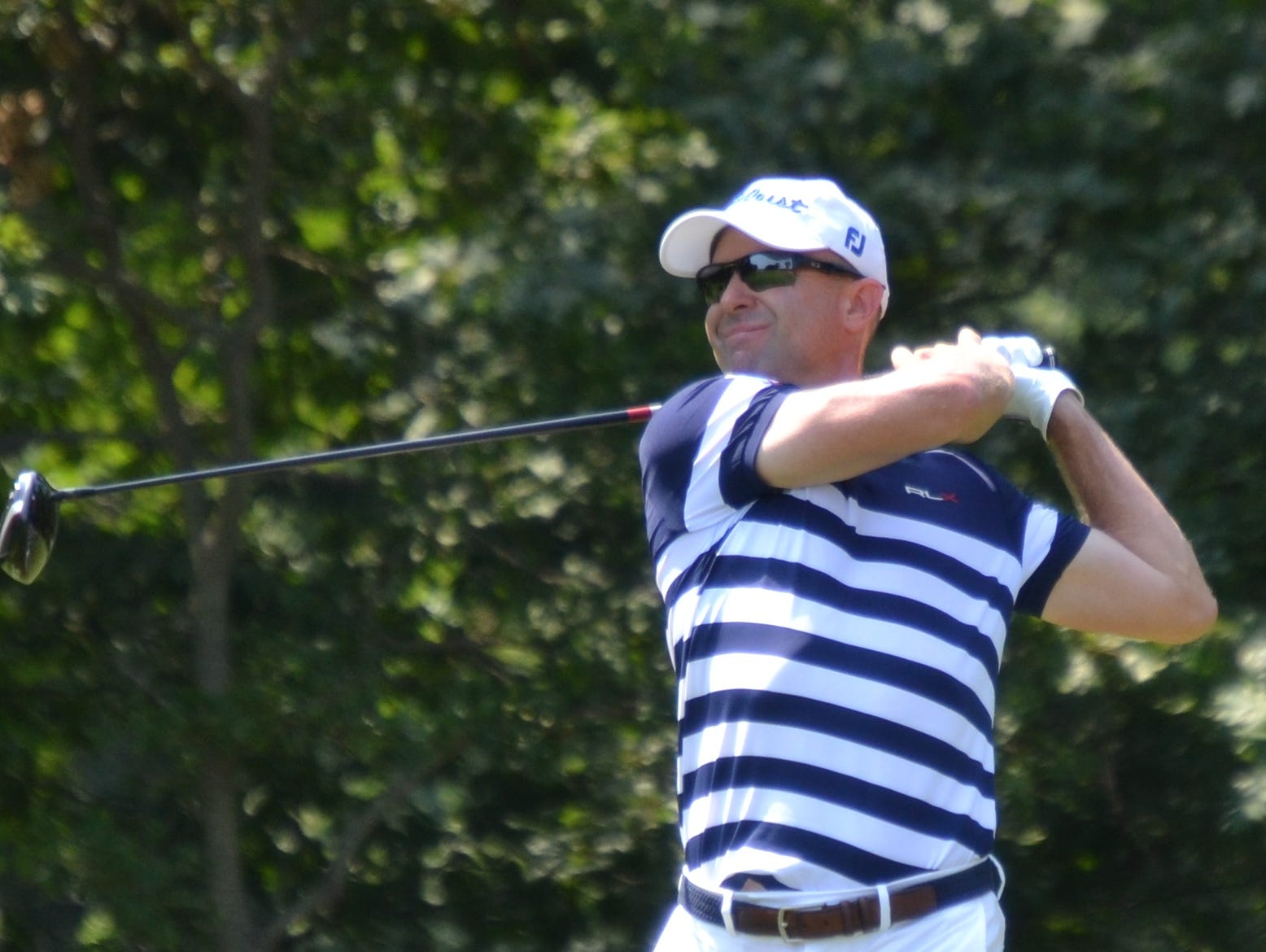 Rob Labritz tees off at the 16th hole Thursday during the final round of the New York State Open at Bethpage State Park. The GlenArbor director of golf won on the first hole of sudden death.