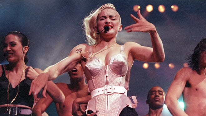 """Madonna is seen with her backup dancers during a """"Blond Ambition"""" tour performance in Worcester, Mass."""