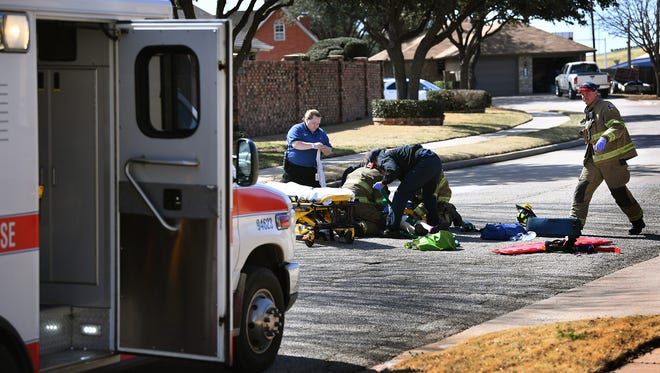 Emergency personnel treat an elderly female after she was struck  by a Chevrolet pickup truck while walking on Nottinghill Lane near Prince Edward Drive.