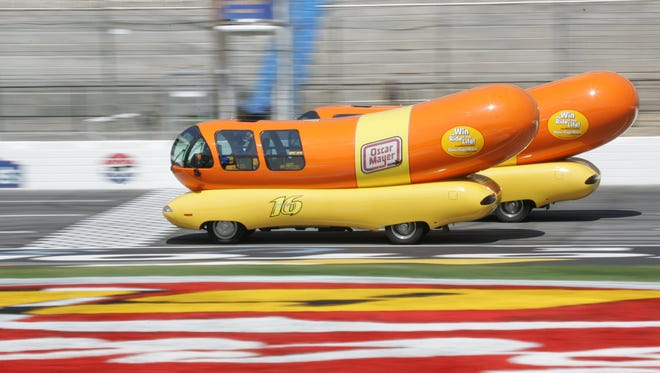 In this photo provided by Oscar Mayer, NASCAR Driver Kurt Busch crosses the finish line ahead of Greg Biffle, Michel Jourdain and Todd Kleuever in the famed Oscar Mayer Wienermobile vehicles at Lowe's Motor Speedway in Concord, N.C.