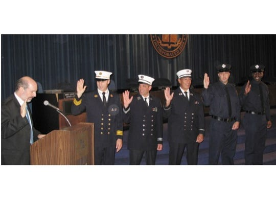 New Rochelle Deputy Mayor Barry Fertel swears in new and promoted firefighters during a City Hall ceremony, Oct. 20, 2014. From left: Deputy Chief Scott Bradley, Capt. Paul Alfano, Lt. Ricardo Ramos, and probationary firefighters Louis Bongo and Neil Brown.