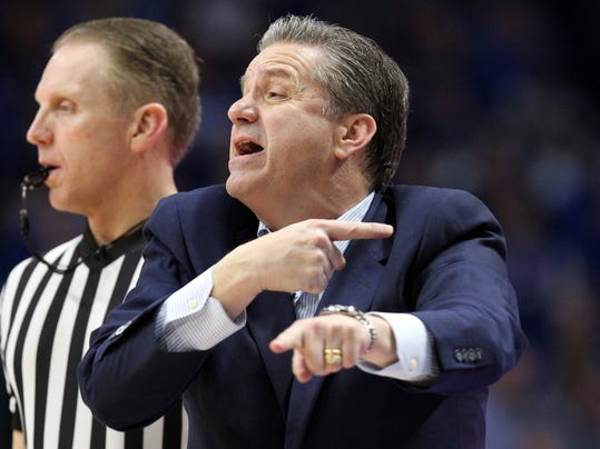 Kentucky coach John Calipari gestures to his team during the second half of an NCAA college basketball game against Mississippi, Wednesday, Feb. 28, 2018, in Lexington, Ky. Kentucky won 96-78. (AP Photo/James Crisp)