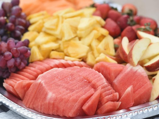 A platter of sliced fresh fruit was served with assorted salsas and chips.