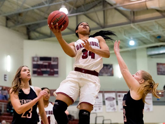Oak Ridge's Mykia Dowdell (34) goes for a layup during