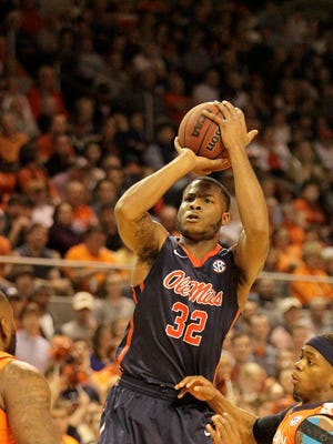 Ole Miss guard Jarvis Summers (32) takes a shot over Auburn forward Cinmeon Bowers (5) and guard Tahj Shamsid-Deen (13) during the first half at Auburn Arena.