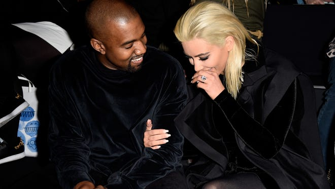 Kanye West and Kim Kardashian West at a fashion show in Paris in March 2015.